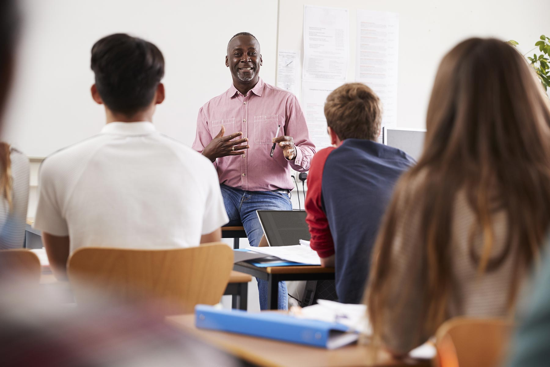 teacher-standing-at-front-of-college-students-for-PLMC7VR.jpg