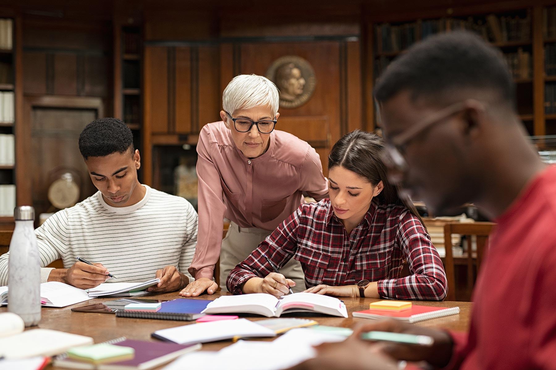 university-students-studying-with-teacher-DVBPU45.jpg